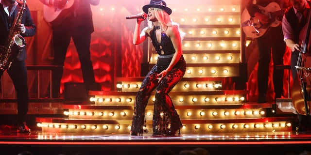 Carrie Underwood performs onstage during the 53rd annual CMA Awards. (Photo by Terry Wyatt/Getty Images,)