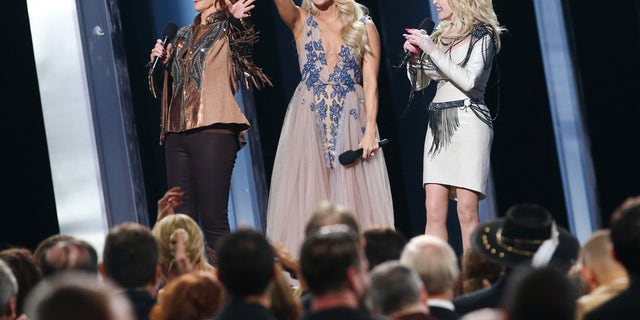 Reba McEntire, Carrie Underwood and Dolly Parton closing out the CMA Awards. (Photo by Terry Wyatt/Getty Images,)