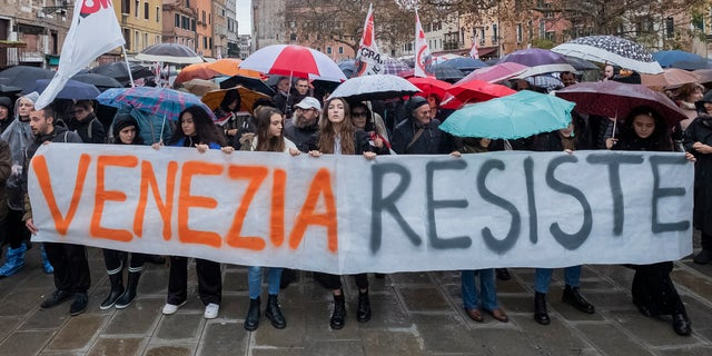 """""""Venetians have just endured a deep wound. The flooding... brought this city to its knees and revealed its extreme fragility to the world,"""" one activist said."""