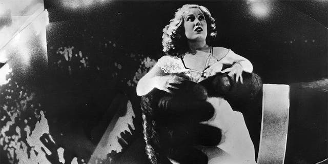 """American actress Fay Wray in the clutches of King Kong, in a scene from the old Hollywood movie """"King Kong"""" directed by Merian C Cooper and Ernest B Schoedsack for RKO."""