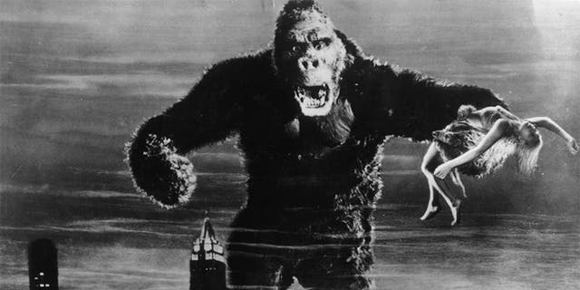 """One of John Cerisoli's models of the giant ape, poised above the New York skyline in a scene from the classic monster movie """"King Kong."""" In one of his enormous hands is leading lady Fay Wray, the film's heroine."""