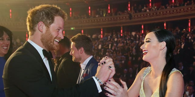 Country star Kacey Musgraves greeted Prince Harry with a high-five after the Royal Variety Performance at the Albert Hall on November 13, 2015 in London, England. (Photo by Paul Hackett - WPA Pool/Getty Images)