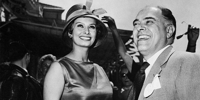 Sophia Loren and Carlo Ponti, her spouse, at the Cannes Film Festival, circa 1959.
