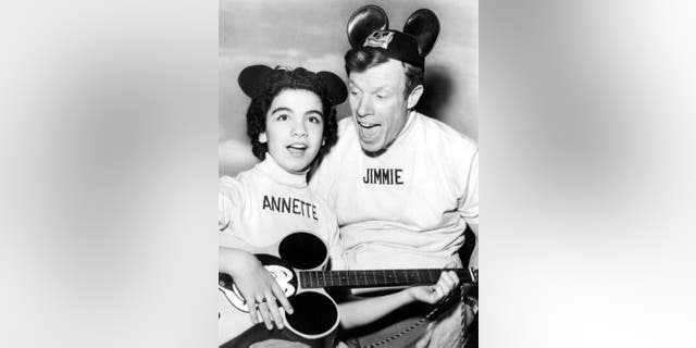 "Annette Funicello and Jimmie Dodd on ""The Mickey Mouse Club"" television show, Hollywood, California, May 1956."