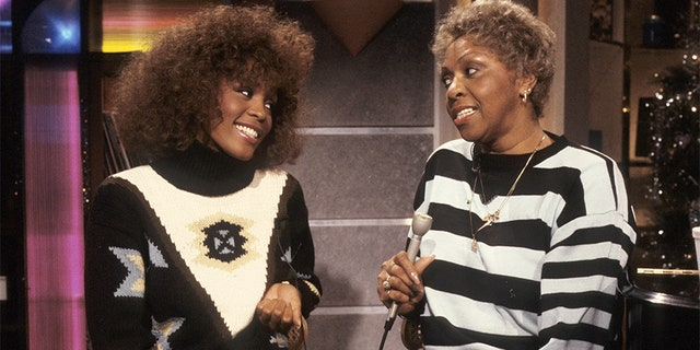 From left, American vocalist Whitney Houston and her mother, fellow singer Cissy Houston, appear during a taping of an MTV show, New York, New York, 1989.