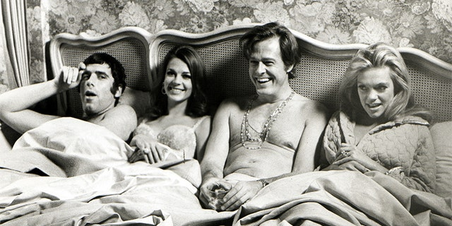 """(Left to right) Elliott Gould, Natalie Wood, Robert Culp and Dyan Cannon in a promotional still from the 1969 film, """"Bob and Carol and Ted and Alice."""""""
