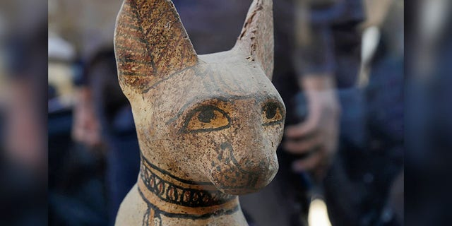 A cat statue that was found inside a cache, at the Saqqara area near its necropolis is pictured in Giza, Egypt, Saturday. (REUTERS/Hayam Adel)