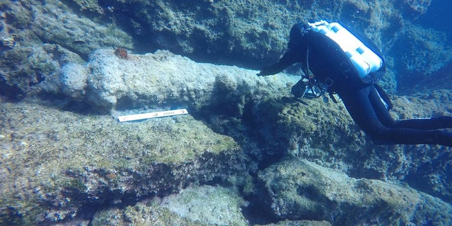 An iron cannon at the wreck site. (photo by C. Hoye)