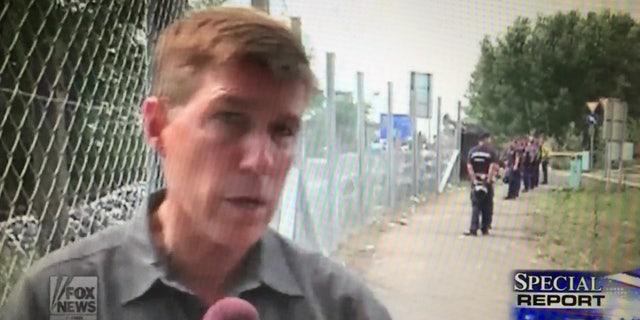 Greg Palkot covering migrants in Roszke, in the Hungary-Serbia border.