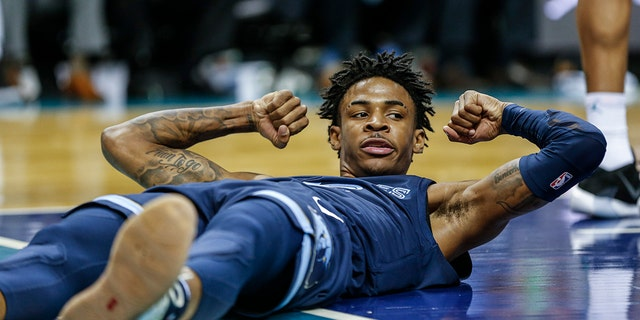Memphis Grizzlies guard Ja Morant flexes after being fouled in the first half of an NBA basketball game against the Charlotte Hornets in Charlotte, N.C., Wednesday, Nov. 13, 2019. (AP Photo/Nell Redmond)