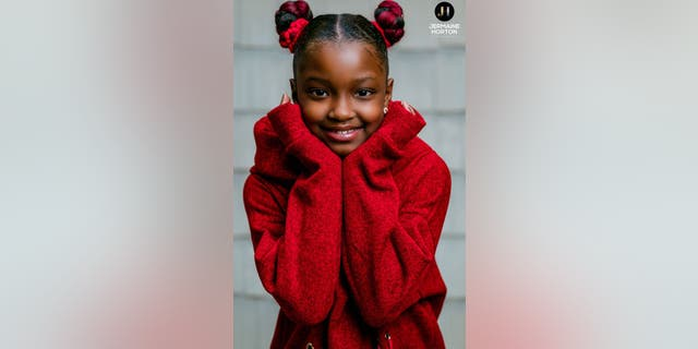 Marian Scott, 8, was all smiles during a recent, personalized photoshoot with Jermaine Horton Photography.