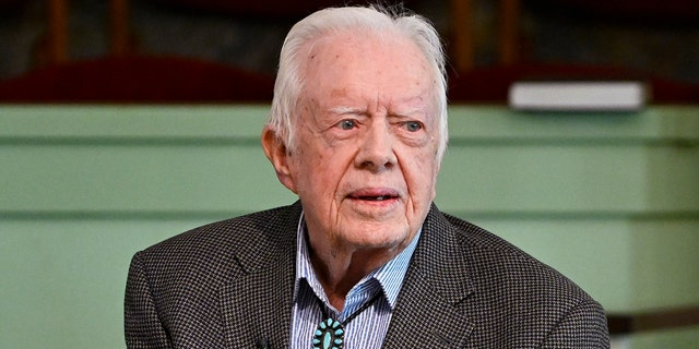 Former President Jimmy Carter, who was spotted here earlier this month in Georgia, was hospitalized on Monday. (AP Photo / John Amis, File)