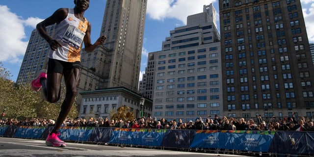 Geoffrey Kamworor, of Kenya, leads the professional men's division during the New York City Marathon, Sunday, Nov. 3, 2019, in New York.