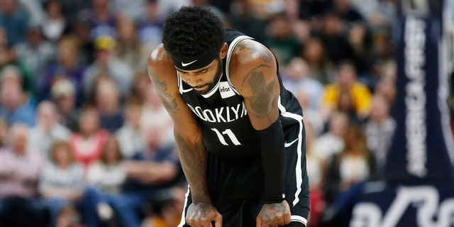 Brooklyn Nets guard Kyrie Irving (11) looks down at the court during the second half of the team's NBA basketball game against the Utah Jazz on Tuesday, Nov. 12, 2019, in Salt Lake City. (AP Photo/Rick Bowmer)