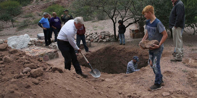 Men dug a mass grave for some of the victims who were killed in Monday's Mexican cartel ambush. (AP Photo/Marco Ugarte)