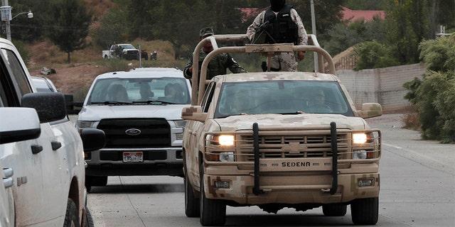 Soldiers patrol La Mora ahead of the funeral Thursday. (AP Photo/Marco Ugarte)