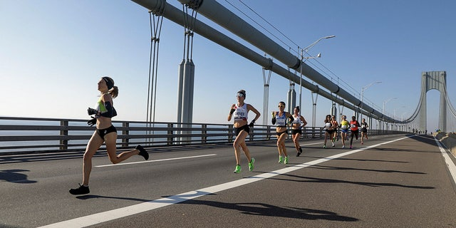 Competitors in the elite women's runners division make their way across the Verrazano-Narrows Bridge during the start of the New York City Marathon, Sunday, Nov. 3, 2019, in New York.