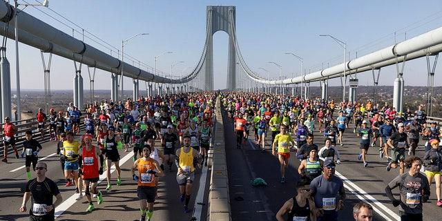 Runners make their way across the Verrazano-Narrows Bridge during the start of the New York City Marathon, Sunday, Nov. 3, 2019, in New York.