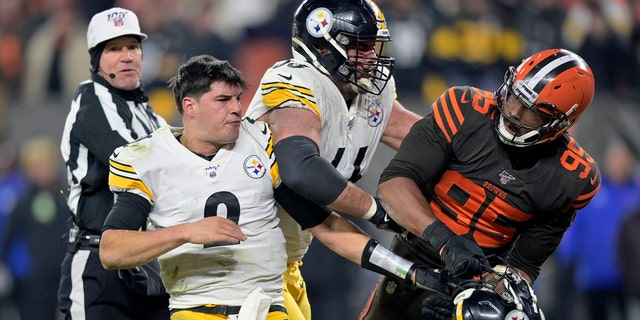 Cleveland Browns defensive finish Myles Garrett (95) reacts after overhanging a helmet during Pittsburgh Steelers quarterback Mason Rudolph (2) in a fourth entertain of an NFL football game, Thursday, Nov. 14, 2019, in Cleveland. The Browns won 21-7. (AP Photo/David Richard)