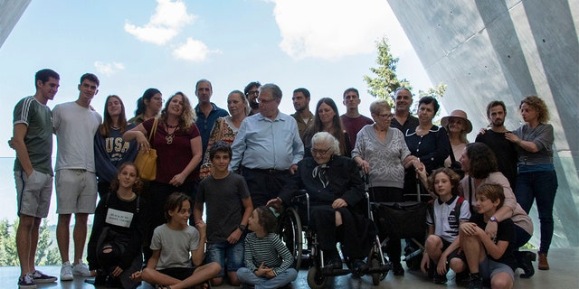 Melpomeni Dina, center right, posing for a group photo during the reunion at the Yad Vashem Holocaust memorial in Jerusalem.