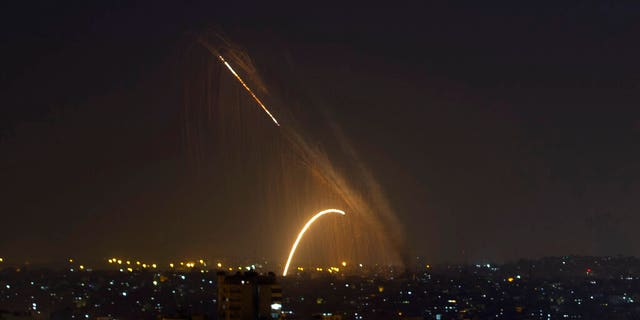 Rockets are launched from the Gaza Strip towards Israel, Wednesday, Nov. 13, 2019. (AP Photo/Khalil Hamra)