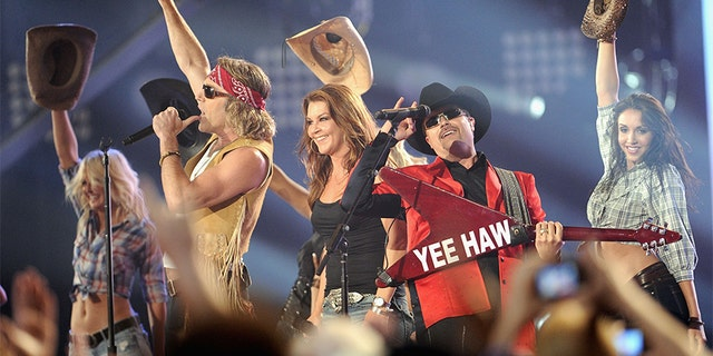 Musicians Big Kenny, Gretchen Wilson and John Rich of Big and Rich perform on stage at the 2011 CMT Music Awards at the Bridgestone Arena on June 8, 2011 in Nashville, Tennessee.