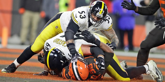 Cleveland Browns defensive end Myles Garrett (95) is punched by Pittsburgh Steelers center Maurkice Pouncey (53) and tackled by offensive guard David DeCastro (66) during the second half of an NFL football game Thursday, Nov. 14, 2019, in Cleveland. The Browns won 21-7. (Associated Press)