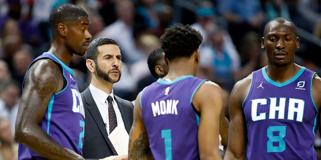 Charlotte Hornets coach James Borrego huddles with his team during a break in the first half of the team's NBA basketball game against the Boston Celtics in Charlotte, N.C., Thursday, Nov. 7, 2019.