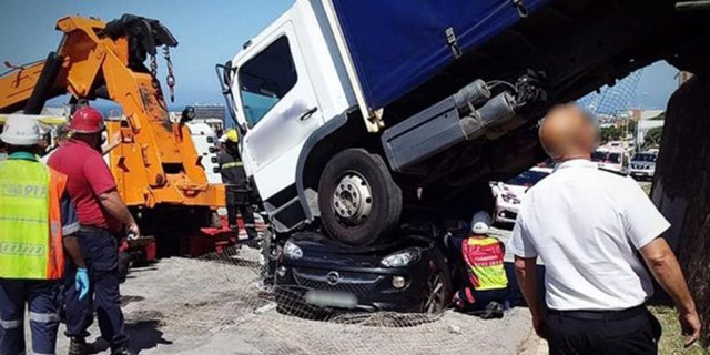 A 26-year-old woman suffered serious injuries after a truck landed on top of her car in South Africa on Tuesday.聽