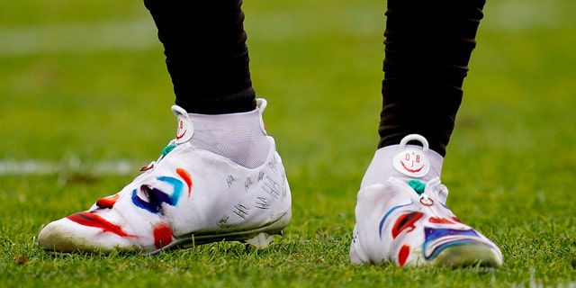 Cleveland Browns wide receiver Odell Beckham wears a pair of custom cleats during the first half of NFL football game against the Denver Broncos, Sunday, Nov. 3, 2019, in Denver. The NFL made both Beckham and Jarvis Landry change their cleats at halftime. (AP Photo/Jack Dempsey)