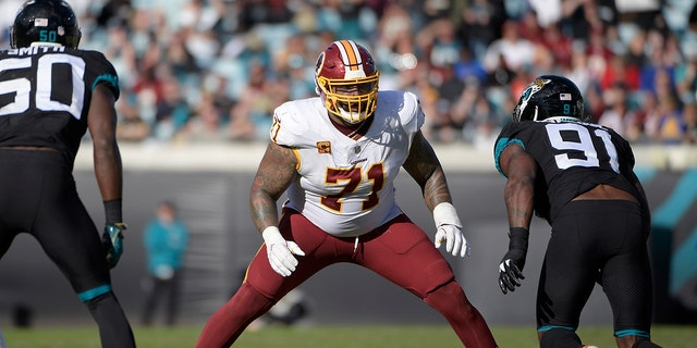 FILE - In this Dec. 16, 2018, file photo, Washington Redskins offensive tackle Trent Williams (71) sets up to block in front of Jacksonville Jaguars defensive end Yannick Ngakoue (91) during the second half of an NFL football game in Jacksonville, Fla. (AP Photo/Phelan M. Ebenhack, File)
