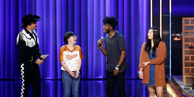 "Jimmy Fallon with UT Austin students Alma Zamora (left), Fitzgerald Alan (middle) and Elizabeth Yoon (right) during the ""Samsung Phone Giveaway."""