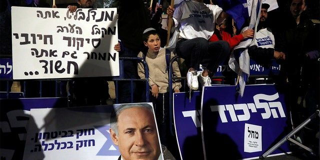Netanyahu supporters demonstrate outside his home following his indictment last week.