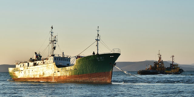 A file picture of a North Korean fishing boat. Officials said that two North Korean fishermen were deported from South Korea after investigators found they killed their crewmembers and dumped their bodies at sea before fleeing and seeking asylum.