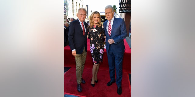 Pat Sajak, Vana White, Alex Trebek at the Hollywood Walk of Fame (Photo by Roden Ekenroth / WireImage)