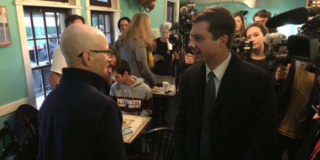 Presidential candidate Pete Buttigieg greeting supporters at a cafe in Portsmouth, N.H., on Monday.
