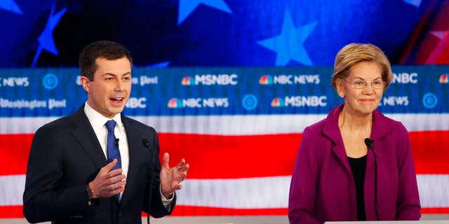 Democratic presidential candidate South Bend, Ind., Mayor Pete Buttigieg speaks as Democratic presidential candidate Sen. Elizabeth Warren, D-Mass., listens during a Democratic presidential primary debate, Wednesday, Nov. 20, 2019, in Atlanta. (AP Photo/John Bazemore)