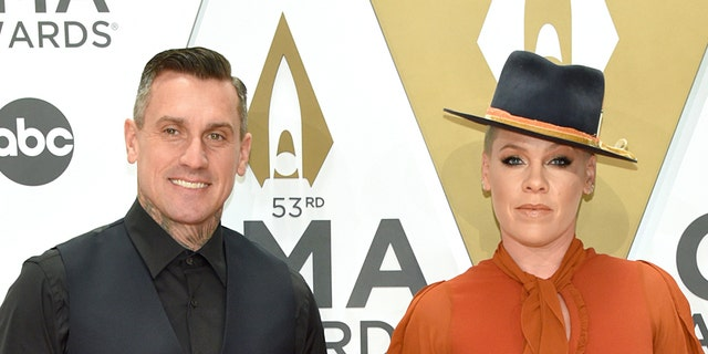 P!nk and Carey Hart attend the 53rd annual CMA Awards at the Music City Center on November 13, 2019 in Nashville, Tennessee