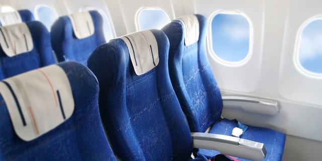Court documents say the man was seated between the female passenger, who was in the aisle, and his minor son, in a window seat.