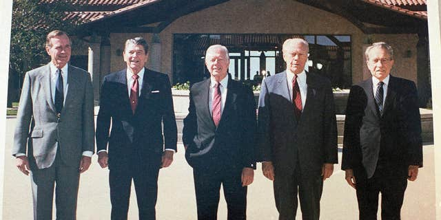 Former Presidents, from left, George H. W. Bush, Ronald Reagan, Jimmy Carter, Gerald Ford and Richard Nixon shown in the courtyard during the dedication of the Ronald Reagan Presidential Library in Simi Valley, Calif., on Nov. 4, 1991. (AP Photo/Marcy Nighswander)