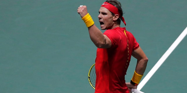 Spain's Rafael Nadal celebrates celebrates a point against Russia's Karen Khachanov during their Davis Cup tennis match in Madrid, Spain, Tuesday, Nov. 19, 2019. (AP Photo/Manu Fernandez)