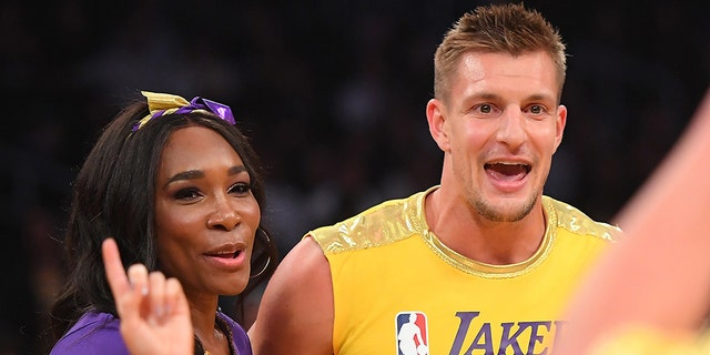 Venus Williams and Rob Gronkowski laugh after participating with the Los Angeles Lakers girls during halftime of the game against the Oklahoma City Thunder at Staples Center on Nov. 19, 2019, in Los Angeles.(Jayne Kamin-Oncea-USA TODAY Sports)