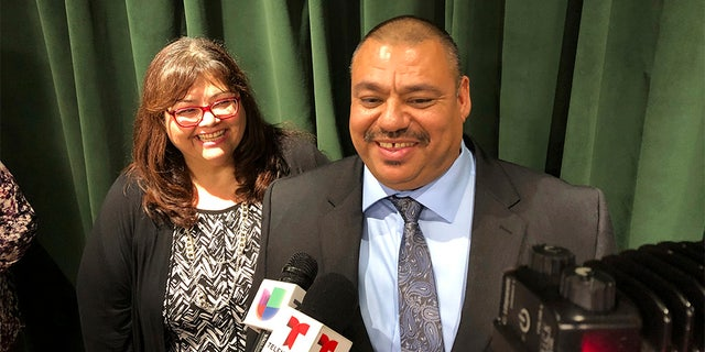 Ruben Martinez Jr., right, and his wife, Maria, left, spoke to reporters at the Hall of Justice in downtown Los Angeles, on Tuesday, Nov. 12. (AP Photo/Brian Melley)