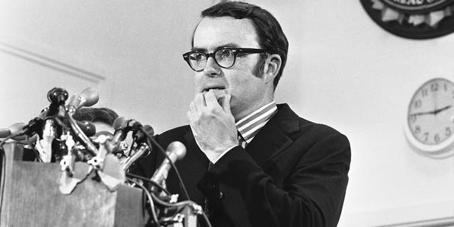 Then-acting FBI director William Doyle Ruckelshaus pauses during a news conference in May 1973. (AP Photo/Charles Gorry)