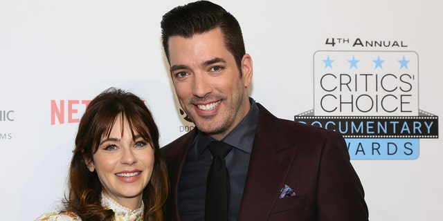 Jonathan Scott is pictured with Zooey Deschanel at the Fourth Annual Critics' Choice Documentary Awards in New York, N.Y., on Nov. 10, 2019.