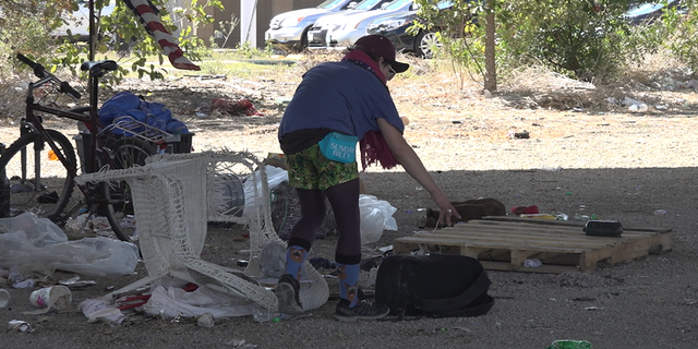 People living in camps under SH 71 spent Monday morning gathering their things ahead of a scheduled cleanup by Texas Department of Transportation.
