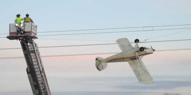 Thomas Koskovich, 65, was safely rescued Saturday after his Piper Cub single-engine plane became entangled in power lines in Louisville Township, Minnesota.