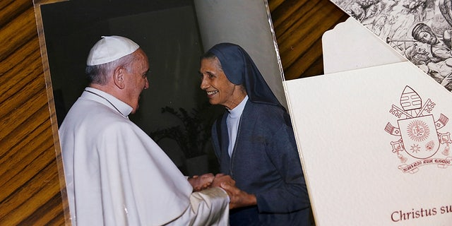 A picture of Pope Francis and Sister Ana Rosa Sivori is seen at the St. Mary School in Udon Thani province, Thailand, September 24, 2019. REUTERS/Jiraporn Kuhakan NO RESALES.