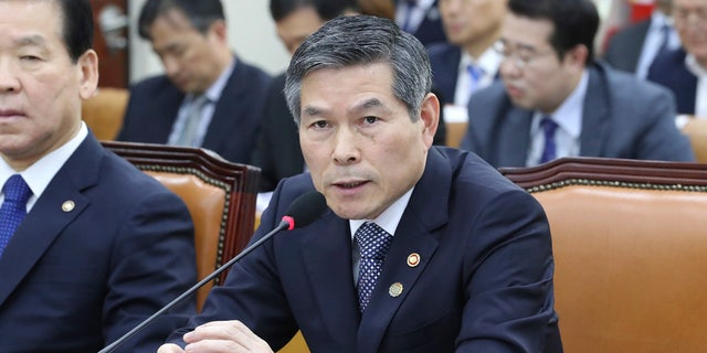 South Korean Defense Minister Jeong Kyeong-doo answers a lawmaker's question about North Koreans' deportation during a defense committee meeting at the National Assembly in Seoul, South Korea, Thursday, Nov. 7, 2019.