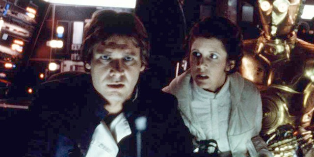 """Harrison Ford and Carrie Fisher on the set of """"Star Wars: Episode V - The Empire Strikes Back"""" directed by Irvin Kershner."""